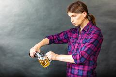 Tapster fills stein from bottle. Stock Photos
