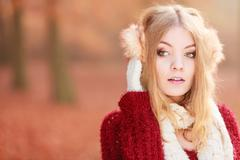 Portrait of pretty gorgeous woman in earmuffs. Stock Photos