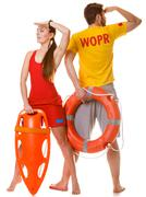 Lifeguards with rescue and ring buoy lifebuoy. - stock photo