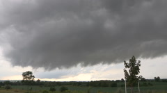 Wall cloud on approaching severe tornado warned thunderstorm Stock Footage