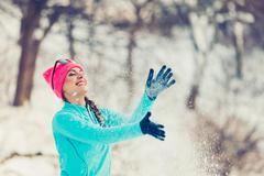Girl tossing snow around Stock Photos