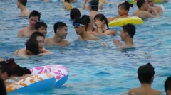 Crowded swimming pool, a lot of people in the swimming Stock Footage