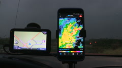 Storm chasing with weather radar and camera technology Stock Footage