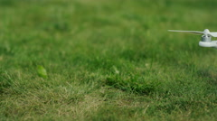 quadrocopter standing on the grass. green background. summer - stock footage