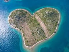 Aerial view of the heart shaped Galesnjak island on the adriatic coast Stock Photos