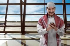 Asian man muslim on airport Stock Photos