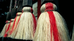 Shinto temple bell ropes with straw ends. Slow motion point of view shot. Stock Footage