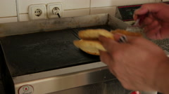 Man turning tortillas for gyros on hot plate close up, fast food shoop by Sheyno Stock Footage