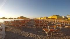 Umbrellas and gazebos on Italian sandy beaches. Adriatic coast. Stock Footage