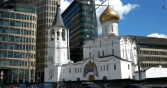 Church of St. Nicholas on a background of modern skyscrapers Stock Footage