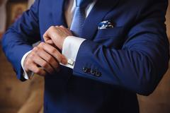 Businessman hands with cufflinks. Elegant gentleman clother Stock Photos