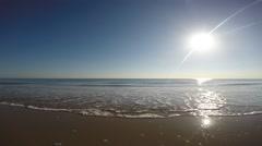 Waves on sandy beach at sunrise. Italian coastline. Stock Footage