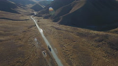 Aerial view of scenic highway through the Lindis Pass Stock Footage