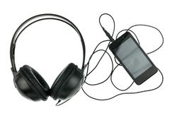 Music concept the black smartphone and black headphone - stock photo