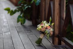 Wedding bouquet. Bride's flowers on wooden background Stock Photos