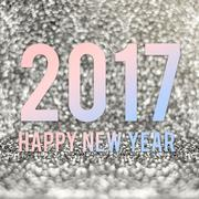 Happy new year 2017 in material color at silver sparkling glitter background Kuvituskuvat
