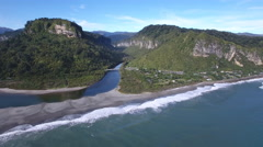 Aerial view of Punakaiki beach and the Pororari River in New Zealand Stock Footage