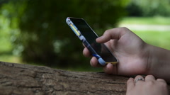Girl with smart phone browsing web outdoor Stock Footage