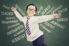 Cheerful boy imagine future jobs at class - stock photo