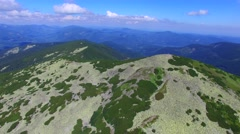Flying over rocky ridges and valleys of Carpathian mountains Stock Footage