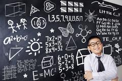 Child and mathematics formula Stock Photos
