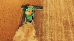 Aerial view of wheat harvesting with modern combine in 4K Stock Footage