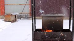 Metal smoker box standing on fire Stock Footage