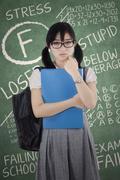 Failed exam and sad girl Stock Photos