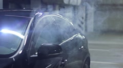 Smoking e-cigarette inside the black car Stock Footage