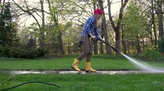 Female worker wash dirty path with special tool Stock Footage