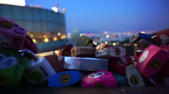 N Seoul Tower lock of love with romantic night view from hill deck Stock Footage