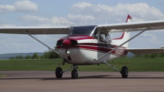 Red Cessna 172 Skyhawk II Airplane Takeoff Arriving at Airport Stock Footage