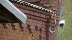 A CCTV camera on the side of the building Stock Footage