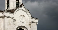 The gate bell tower of the Cathedral of Christ the Savior, sun and storm clouds Stock Footage