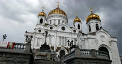 The dome of the Temple of Christ the Savior in the sun, looming clouds Stock Footage