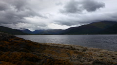 4K UltraHD Storm clouds over Mountains and Loch near Onich, Scotland Stock Footage