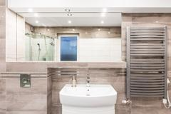 Beige bathroom with heater idea Stock Photos