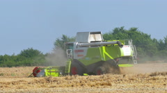 Combine Harvesting ripe wheat Stock Footage