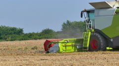 Harvesting of wheat with a modern combine Stock Footage
