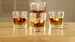 Whiskey bottle and glasses. Stock Footage