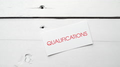 Qualifications written on a card. Business concepts. - stock footage