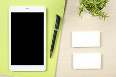Business card blank, smartphone or tablet pc, flower and pen at office desk Kuvituskuvat