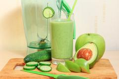 Green smoothie with apple, avocado and cucumber Stock Photos