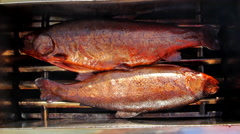 Two smoke-dried delicious fishes Stock Footage