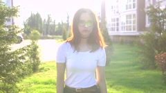 Video portrait teenage girl wearing glasses look at camera smile show braces Stock Footage