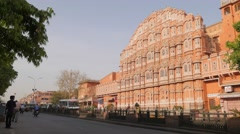 Hawa Mahal or palace of winds with street traffic,Jaipur,India Stock Footage