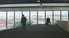 People walking with luggage in airport waiting hall, business trip, tourism Stock Footage