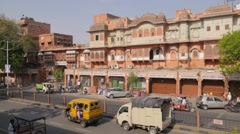 Traffic on street in old city with pink buildings,Jaipur,India Stock Footage