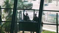 Cleaning service, two male cleaners washing windows in airport, physical labor Stock Footage