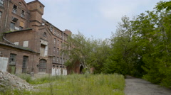 Trees around the old Kreenholm building Stock Footage